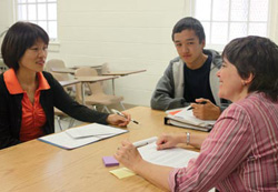 Student and Mother working with School Guidance Counselor Ed.gov Brochure Photo